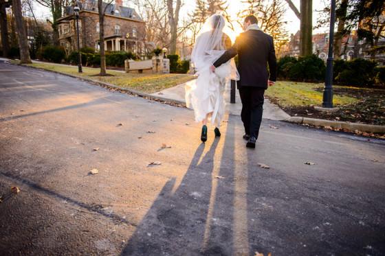 a bride in her wedding dress walking with her groom